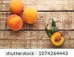 ripe peaches fruit on brown... | Shutterstock . vector #1074264443