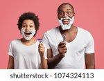 photo of happy schoolboy with... | Shutterstock . vector #1074324113