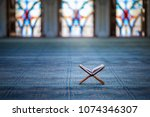 quran   holy book of muslims in ... | Shutterstock . vector #1074346307