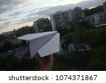 launch a paper airplane from... | Shutterstock . vector #1074371867