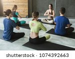 yoga teacher and beginners in... | Shutterstock . vector #1074392663