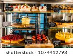 pastry shop glass display with... | Shutterstock . vector #1074412793