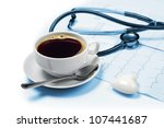 Coffee, electrocardiogram and phonendoscope - stock photo