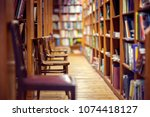 library with rows of books on... | Shutterstock . vector #1074418127