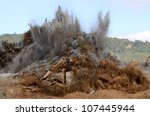 A sequence of images of a blasting operation of a rock hill to make way for an airport runway expansion project. - stock photo