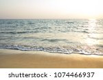 white waves on the beach and...   Shutterstock . vector #1074466937