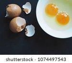 less fresh eggs in white bowl... | Shutterstock . vector #1074497543