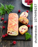 Small photo of Sponge roulade with raspberries and cream.