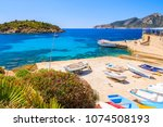 fishing boats on shore in sant... | Shutterstock . vector #1074508193