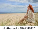 young woman on sand to...   Shutterstock . vector #1074534887