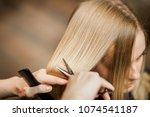 hairdresser stylist cuts with...   Shutterstock . vector #1074541187