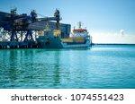 big ship in a dockyard scenic... | Shutterstock . vector #1074551423