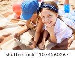 one of two little girls looking ...   Shutterstock . vector #1074560267