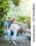 affectionate senior couple... | Shutterstock . vector #1074564863