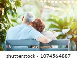 back view of affectionate... | Shutterstock . vector #1074564887