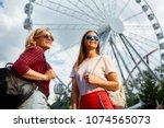 smiling girls with trendy... | Shutterstock . vector #1074565073