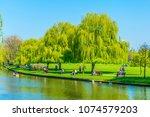 view of riverside promenade of... | Shutterstock . vector #1074579203