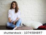 beautiful girl artist at work...   Shutterstock . vector #1074584897
