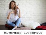 beautiful girl artist at work...   Shutterstock . vector #1074584903