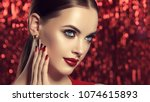 beautiful model girl with red... | Shutterstock . vector #1074615893