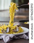 Small photo of Fresh plated seafood alfredo linguine with clams food styling bite taken