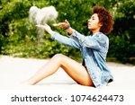 beautiful young african...   Shutterstock . vector #1074624473