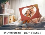 happy mother's day  mom and her ... | Shutterstock . vector #1074646517