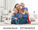 mother and her children playing ... | Shutterstock . vector #1074646523