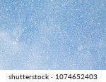 snowflakes on blue sky... | Shutterstock . vector #1074652403