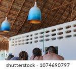 decorative lanterns under palm...   Shutterstock . vector #1074690797