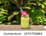 avocado green shake or smoothie ... | Shutterstock . vector #1074700883
