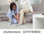 help to dress. elder woman... | Shutterstock . vector #1074783803
