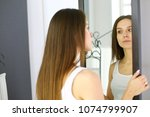 young woman looking herself... | Shutterstock . vector #1074799907