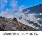 sulphur gas coming out of the... | Shutterstock . vector #1074807557