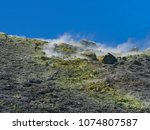 sulphur gas coming out of the... | Shutterstock . vector #1074807587