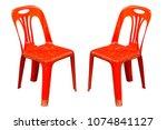 red plastic chair on white... | Shutterstock . vector #1074841127