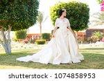 sensual woman in white wedding... | Shutterstock . vector #1074858953