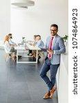 portrait of young businessman... | Shutterstock . vector #1074864923