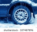 close up shot of a tire in winter time - stock photo