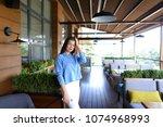 caucasian young female person... | Shutterstock . vector #1074968993