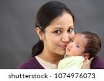 young mother kissing her... | Shutterstock . vector #1074976073