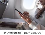 attractive female passenger of... | Shutterstock . vector #1074985703