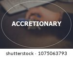 Small photo of Accretionary word with blurring business background