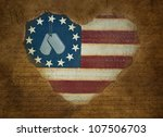 military dog tags on flag heart with grungy overlay - stock photo