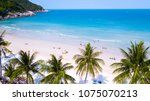 Small photo of Tropical beach with people enjoy summer time at sandy coast line of koh Phangan island,Haad Rin area,Thailand