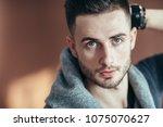 close up portrait of handsome...   Shutterstock . vector #1075070627
