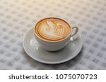 the hot coffee art in the white ... | Shutterstock . vector #1075070723