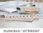 Small photo of Word AMENDMENT composed of wooden letters. Closeup