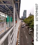 Small photo of Jakarta, Indonesia - April 23, 2018: Crossing bridges make it easier for passengers to move to another station and continue the journey