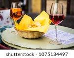 wine glasses on bistro table... | Shutterstock . vector #1075134497